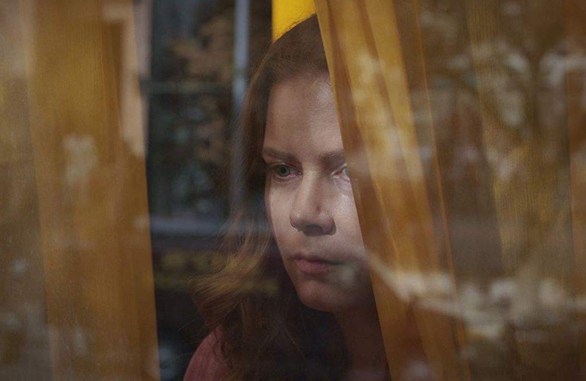 Woman in the Window is a Hitchcock movie for the poor and tired of home quarantine