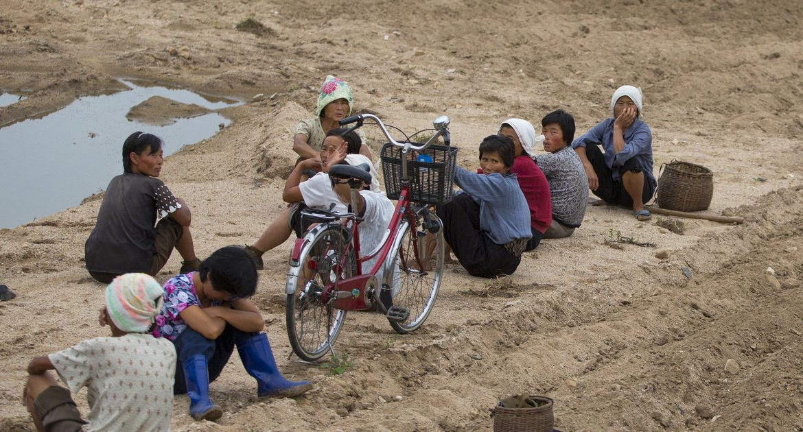 Famine in North Korea.  Street beggars The system is running out of wrestling