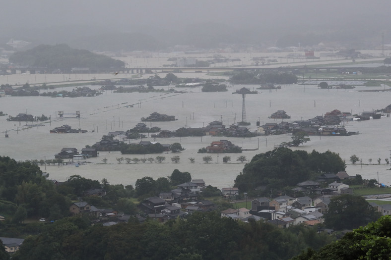 The view shows flooded houses and rice fields in a flooded area in Takeo, Saga Prefecture.  August 14, 2021