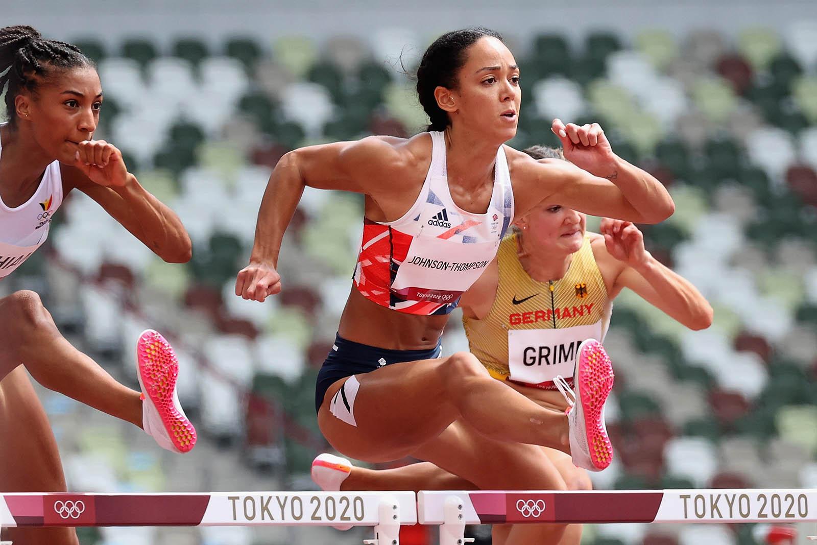 Johnson-Thompson, center, kicks off the women's seven-legged 100m hurdles Wednesday.