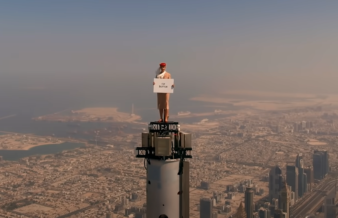 It really happened.  They put the woman on top of the Burj Khalifa