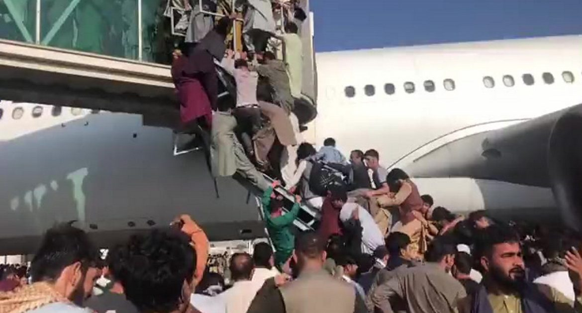 Kabul.  Chaos at the airport.  In the background you can hear shots and screams of people