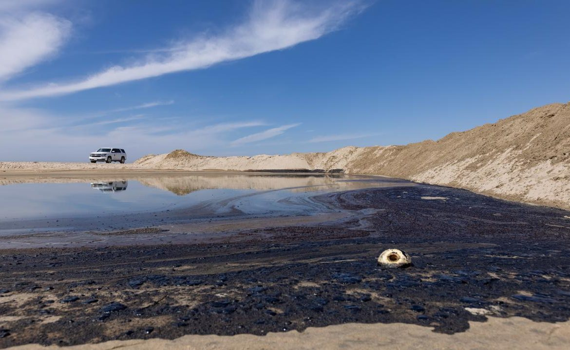 California oil spill.  The oil stain is removed.  Weather can make work difficult