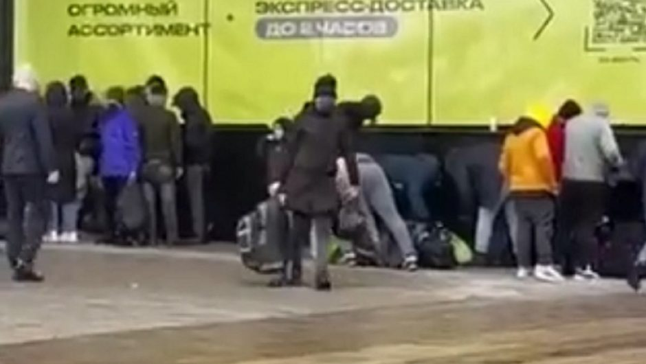 """Groups of immigrants in the capital of Belarus.  """"Many of them believed the sting and became its hostages."""" 